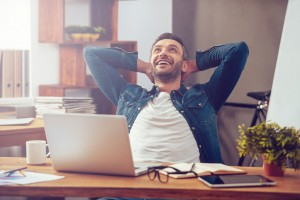 Happy guy at computer (shutterstock) 2